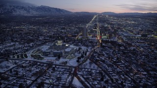 AX128_051 - 6K stock footage aerial video of circling north around the capitol and Downtown Salt Lake City with winter snow at twilight, Utah