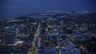 AX128_072 - 6K stock footage aerial video fly over Main Street toward State Street in Downtown SLC with winter snow at night, Utah