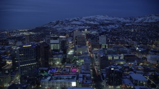 AX128_073 - 6K stock footage aerial video of following State Street through Downtown SLC and approach capitol with winter snow at night, Utah