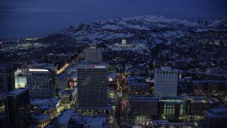 AX128_074 - 6K stock footage aerial video approach Utah State Capitol at end of State Street from Downtown SLC with winter snow at night