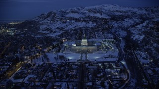 AX128_075 - 6K stock footage aerial video approach Utah State Capitol with winter snow at night, Salt Lake City
