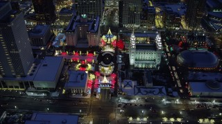AX128_084 - 6K stock footage aerial video orbit Salt Lake Temple with Christmas lights and winter snow at night, Downtown Salt Lake City, Utah