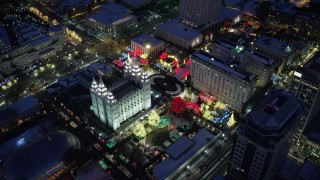 AX128_088 - 6K stock footage aerial video orbit Salt Lake Temple decorated for Christmas with snow at night, Downtown Salt Lake City, Utah