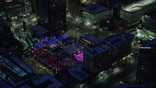 AX128_092 - 6K stock footage aerial video orbit Christmas tree at Gallivan Center with winter snow at night, Downtown Salt Lake City, Utah