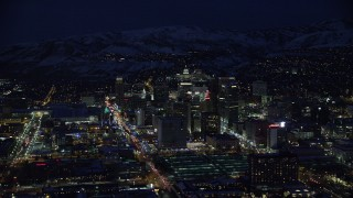 AX128_101 - 6K stock footage aerial video orbit Downtown Salt Lake City in winter at night, Utah