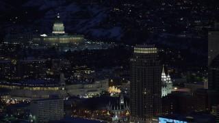 AX128_103 - 6K stock footage aerial video orbit the Utah State Capitol and Salt Lake Temple at night in winter, Downtown Salt Lake City, Utah