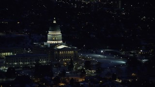 AX128_108 - Aerial stock footage of 6K stock aerial footage video orbit of the state capitol building with winter snow at night, Salt Lake City, Utah