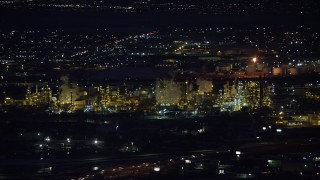 AX128_111 - 6K stock footage aerial video of orbiting a large refinery at night in wintertime, Salt Lake City, Utah