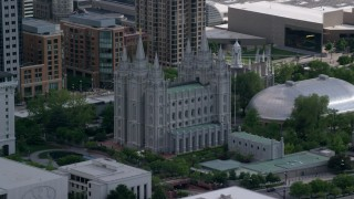 AX129_010 - 6K stock footage aerial video of flying by Salt Lake Temple and Mormon Tabernacle, Downtown Salt Lake City, Utah