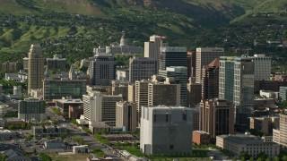 AX129_016 - 6K stock footage aerial video of flying by city buildings, revealing Utah State Capitol, Downtown Salt Lake City, Utah