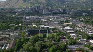 AX129_029 - 6K stock footage aerial video of Spring Mobile Ballpark and Downtown Salt Lake City, Utah