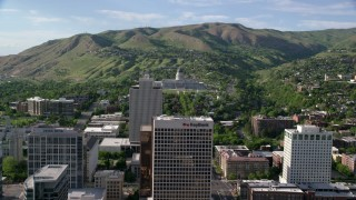 AX129_054 - 6K stock footage aerial video approach Utah State Capitol from city buildings, Downtown Salt Lake City, Utah
