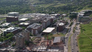 AX129_072 - 6K stock footage aerial video of flying by University of Utah Hospital buildings, Salt Lake City, Utah