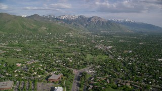 AX129_080 - 6K stock footage aerial video of flying over suburbs, approaching Wasatch Range, Salt Lake City, Utah