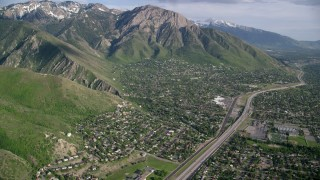 AX129_089 - 6K stock footage aerial video of flying toward suburban neighborhoods, Wasatch Range, Salt Lake City, Utah