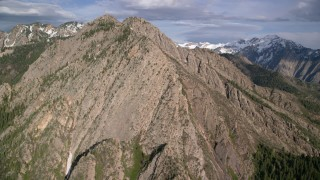 AX129_095 - 6K stock footage aerial video of flying by Mount Olympus, Wasatch Range, Utah