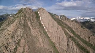 AX129_096 - 6K stock footage aerial video of passing by Mount Olympus, Wasatch Range, Utah