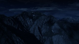 AX129_098_DFN - Aerial stock footage of 4K day for night color corrected aerial footage of flying by Mount Olympus, Wasatch Range, Utah