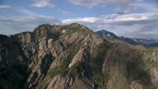 AX129_099 - 6K stock footage aerial video of passing Mount Olympus, Wasatch Range, Utah