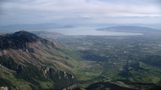 AX129_119 - 6K stock footage aerial video of flying by American Fork, Utah Lake, seen from Wasatch Range, Utah