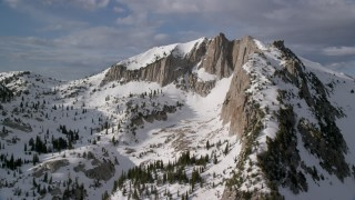 AX129_123 - 6K stock footage aerial video of Lone Peak in the Wasatch Range, Utah