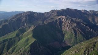 AX129_133 - 6K stock footage aerial video of flying by Mount Olympus in the Wasatch Range, Mount Olympus, Utah