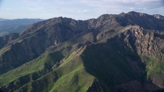 AX129_134 - 6K stock footage aerial video of passing by Mount Olympus in the Wasatch Range, Mount Olympus, Utah