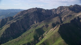 AX129_135 - 6K stock footage aerial video of passing Mount Olympus in the Wasatch Range, Utah