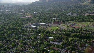AX129_142 - 6K stock footage aerial video fly over suburbs to approach University of Utah sports fields, Salt Lake City, Utah