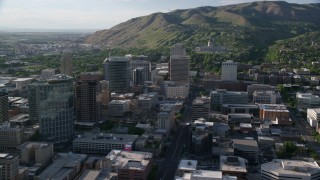 AX129_146 - 6K stock footage aerial video flyby city buildings, Utah State Capitol at end of State Street, Downtown Salt Lake City, Utah