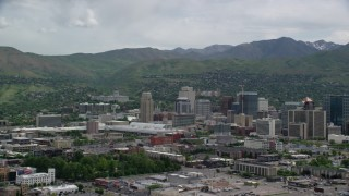 AX130_007 - 6K stock footage aerial video of flying by Downtown Salt Lake City, Utah State Capitol