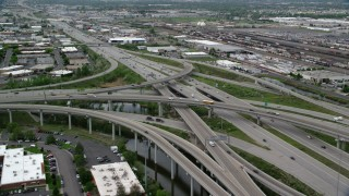 AX130_011 - 6K stock footage aerial video approach and fly over I-80 and I-15 interchange, Salt Lake City, Utah