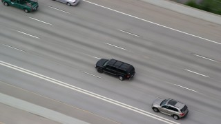 AX130_014 - 6K stock footage aerial video track a black SUV on I-15, light traffic, Salt Lake City, Utah