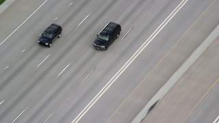 AX130_015 - 6K stock footage aerial video of tracking SUVs on Interstate 15, light traffic, Salt Lake City, Utah