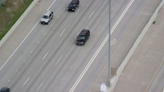 AX130_016 - 6K aerial stock footage video of tracking a black SUV passing light traffic on I-15, Salt Lake City, Utah