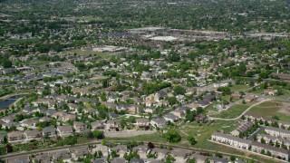AX130_020 - 6K stock footage aerial video of flying over suburban neighborhoods, West Jordan, Utah