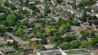 AX130_022 - 6K stock footage aerial video of flying by suburban neighborhood, West Jordan, Utah