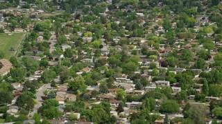 AX130_023 - 6K stock footage aerial video of passing by suburban neighborhoods, West Jordan, Utah