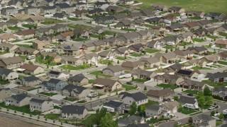 AX130_028 - 6K stock footage aerial video of flying by suburban tract homes, West Jordan, Utah