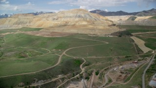 AX130_032 - 6K stock footage aerial video of flying toward Bingham Canyon Mine (Kennecott Copper Mine), Copperton, Utah