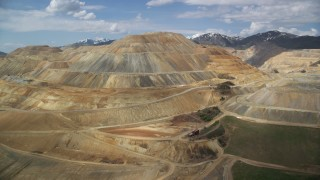 AX130_033 - 6K stock footage aerial video of flying by Bingham Canyon Mine (Kennecott Copper Mine), Utah