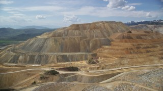AX130_035 - 6K stock footage aerial video flyby Bingham Canyon Mine (Kennecott Copper Mine), Utah