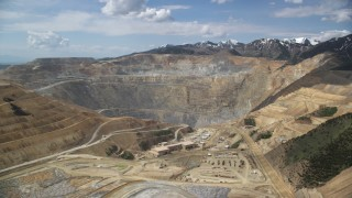 AX130_037 - 6K stock footage aerial video of orbiting Bingham Canyon Mine (Kennecott Copper Mine), Utah