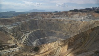 AX130_040 - 6K stock footage aerial video circle the Bingham Canyon Mine (Kennecott Copper Mine), Utah