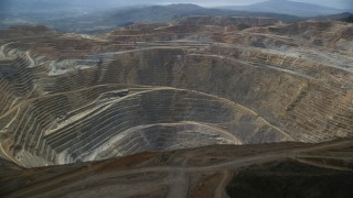 AX130_042 - 6K stock footage aerial video orbiting the rim of Bingham Canyon Mine (Kennecott Copper Mine), Utah