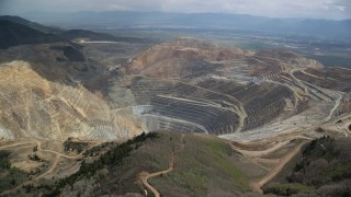 AX130_048 - 6K stock footage aerial video of circling around the Bingham Canyon Mine (Kennecott Copper Mine), Utah