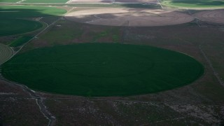 AX130_086 - 6K stock footage aerial video of orbiting green circular crop fields, Elberta, Utah