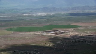 AX130_087 - 6K stock footage aerial video of flying by two green circular crop fields, Elberta, Utah