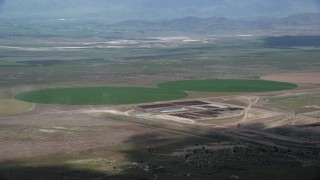 AX130_088 - 6K stock footage aerial video of passing by two green circular crop fields, Elberta, Utah