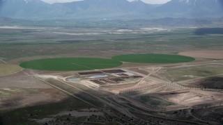 AX130_089 - 6K aerial stock footage video of two green circular crop fields, Elberta, Utah